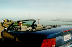Lindsay in the mustang overlooking Golden Gate Bridge